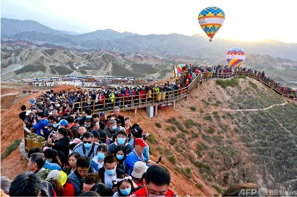 長期休暇の中国市場、予想を超えた回復 写真1枚 国際ニュース:AFPBB News